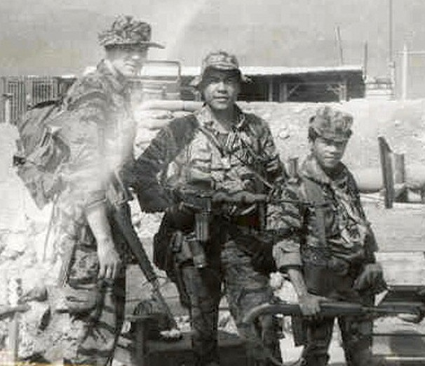 SGT Charles Bailey, Charlie Inot, and CIDG solider assigned to carry PRC-25 radio