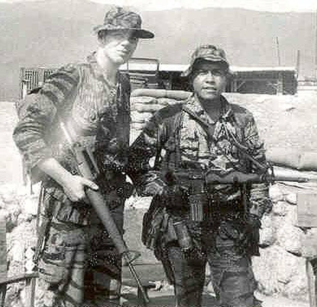 SGT Charles Bailey (Jr. Commo) and Charlie Inot. Just came off patrol, circa Jan. 1968