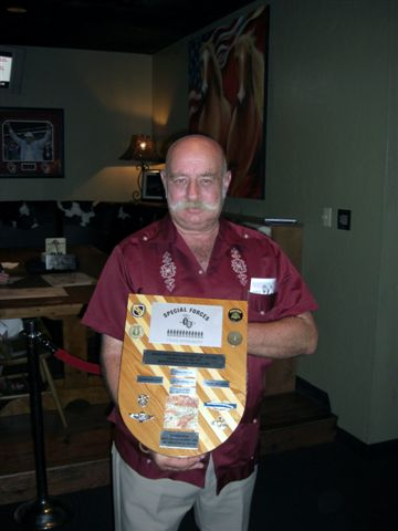 Greg Biela with Plaque He Built