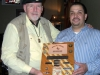 Jim Duffy Presenting Plaque to Manager Dean Alfaro at Toby Keith\'s Bar & Grill
