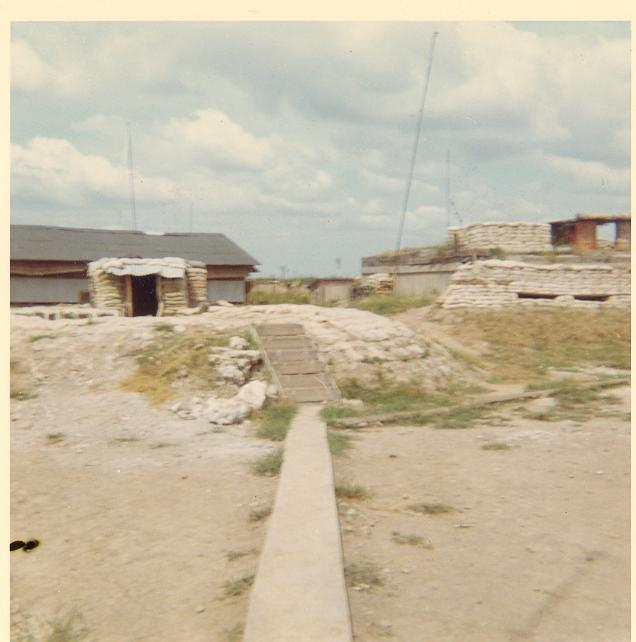 4.2 Mortar Bunker to the left and the camps\' Commo Bunker on the right, A 433
