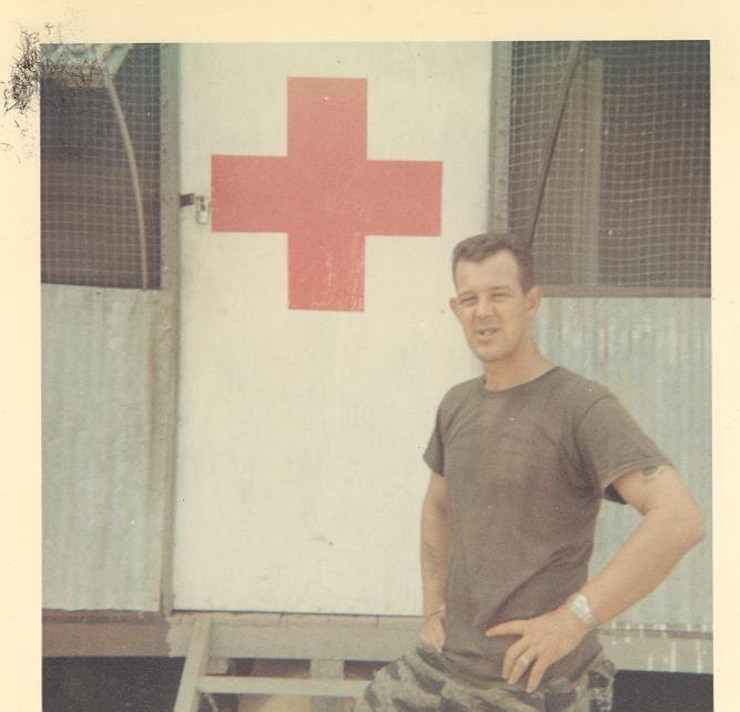 Jim standing near the backdoor of the camp dispensary, A-433.