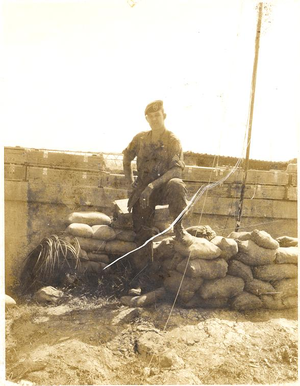 Jim standing next to the commo bunker in camp A-433.