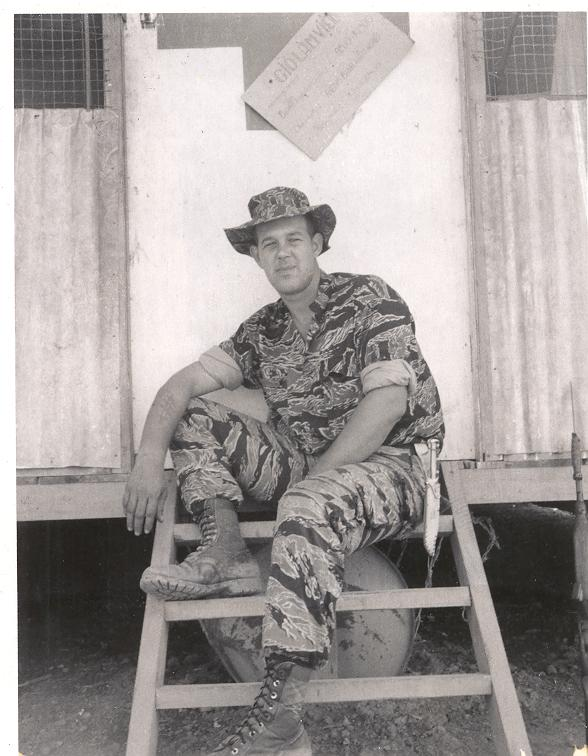 Jim taking a break on the back steps of the dispensary, camp A-433.