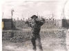 Jim at the south perimeter of camp A-433, in the background, on both sides are machine gun bunkers.