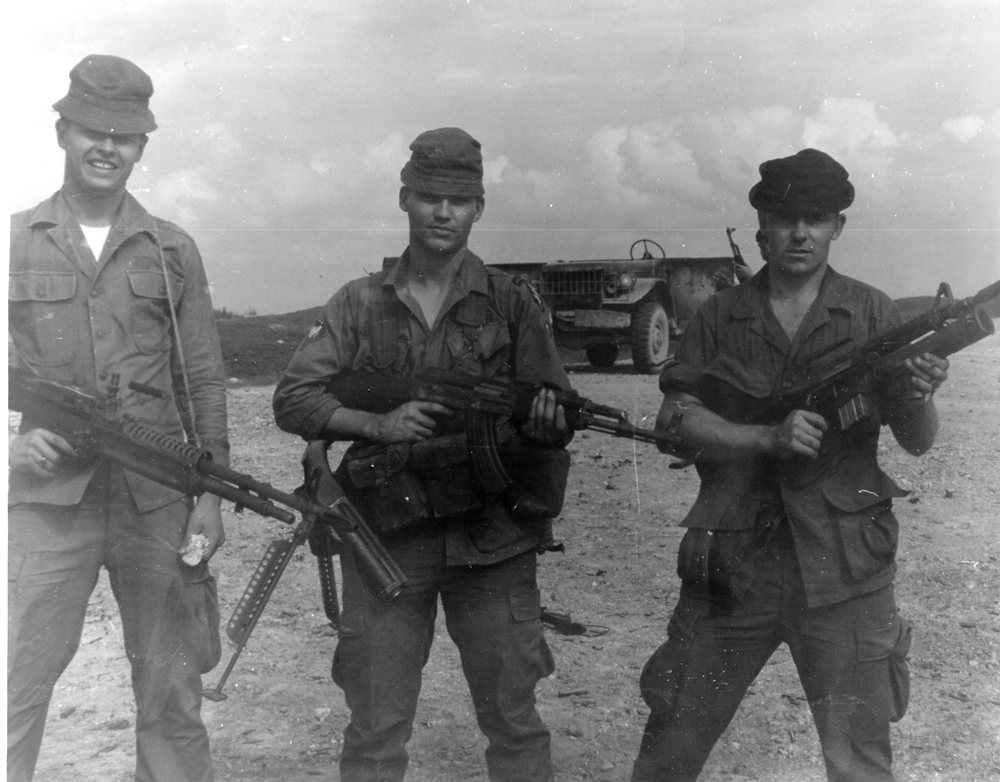 "This photo is on the Phu Bai range, with me, John ""Bubba\"" Shore and Charles Borg, fall of 1968. Note the sawed-off M-79 grenade launcher on Shore\'s right hip. And, not the XM-148 grenade launcher attached to the CAR-15 that Borg is holding. Some SF men liked it. I preferred the old sawed-off M-79."