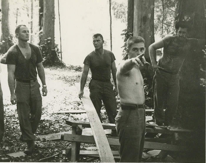 Building B-24 Base Camp, Trang South Thailand, November 1964. L-R, SSG Lonny Holmes, CPT R. Greenwood, SSG O\'Neil, SFC Knuutillia, all of A-432.