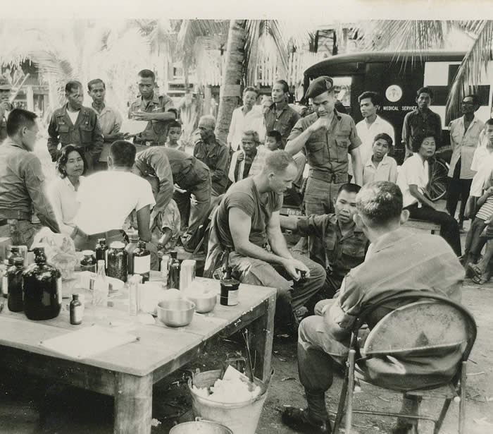 Med Cap with Thai Special Force, 1966. SGT Lonny Holmes 91B4S (18D today) There is no end to treating the poor.