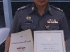 Royal Thai Police Commander, Lt Colonel, holding a copy of our book, Counterinsurgency Training for Police Officers, and a copy of a letter from President George Bush I, regarding the death of SSG Wallace Gumbs