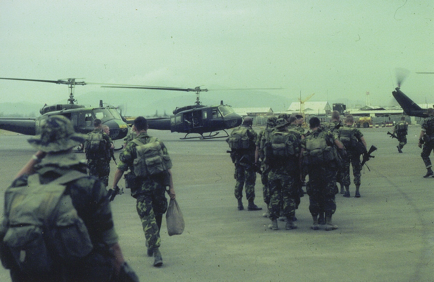 Recon teams loading choppers for insertion RVN