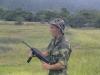 Sgt Mark Miller with M3A1 45 cal greese gun RVN