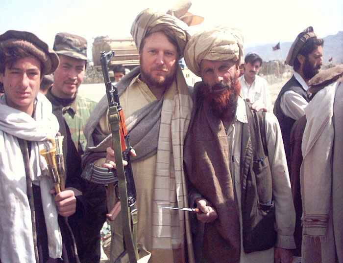 A picture of me and Wally the shit burner just outside Firebase Harriman, Orgune, Afghanistan. We hired the nicest guy in Afghanistan to burn the crap. Each morning after he got everything burning, he would catch us on the way to chow and shake our hands while we were waiting in line. We would wash up again, get in line again, and he would sometimes try to say hi twice.