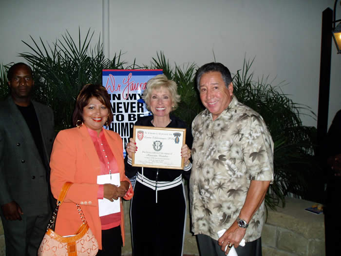 President Ramon Rodriguez and his wife Martha present a special certificate of appreciation