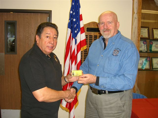 Ramon presents Life Membership card to Jim Duffy