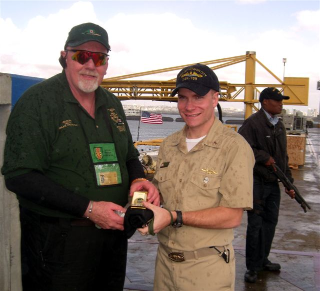 Jim Duffy presenting Chapter 78 Coin and T-Shirt to the Duty Officer for the sub commander