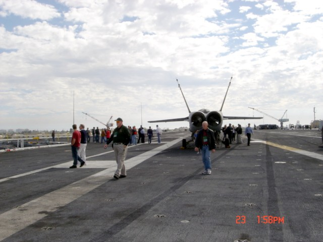 Jim Duffy and Lonny Holmes on carrier deck, Ronald Reagan