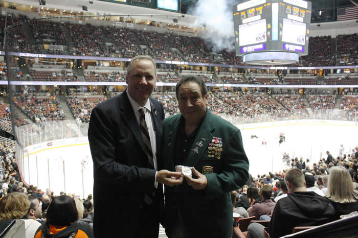 Ramon Rodriguez presenting a Chapter 78 Challange Coin to Ducks C.O.O. Tim Ryan