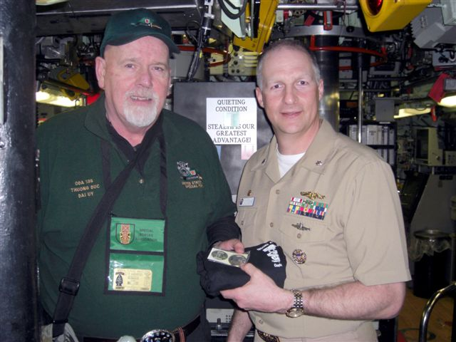 Jim Duffy Presenting Chapter 78 Coin and T-Shirt to CDR Dan Brunk