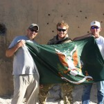 Steve Cowan, Patrick Quinlan and Lonny Holmes with the SF Regimental Flag.