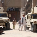 Afghan children warning the ODA of the Taliban's I.E.D.