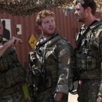 Patrick Quinlan, center, trying to get CPT and Team Sergeant to med evac Ari's father, Moshe.