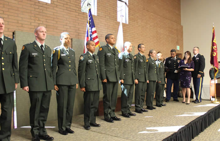 10 members of the USC ROTC Battalion on stage for awards. LTC Robert F. Huntly, Commanding Officer, to right.