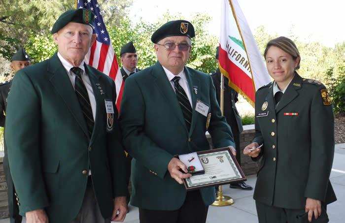 Lonny Holmes, Brad Welker, CSU Fullerton Cadet Jessica Villanueva.