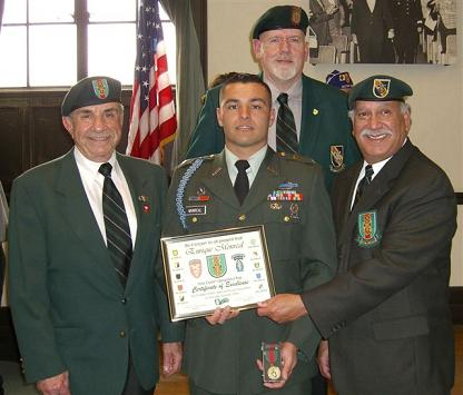 Chapter 78 members (l to r) Richard Simonian, Vice President, Jim Duffy, Asst. Vice President, and Terry Cagnolatti, Treasurer present the ROTC award to Cadet Sergeant Enrique Monreal.