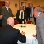 LTG William Boykin signing Terry Cagnolatti's copy.