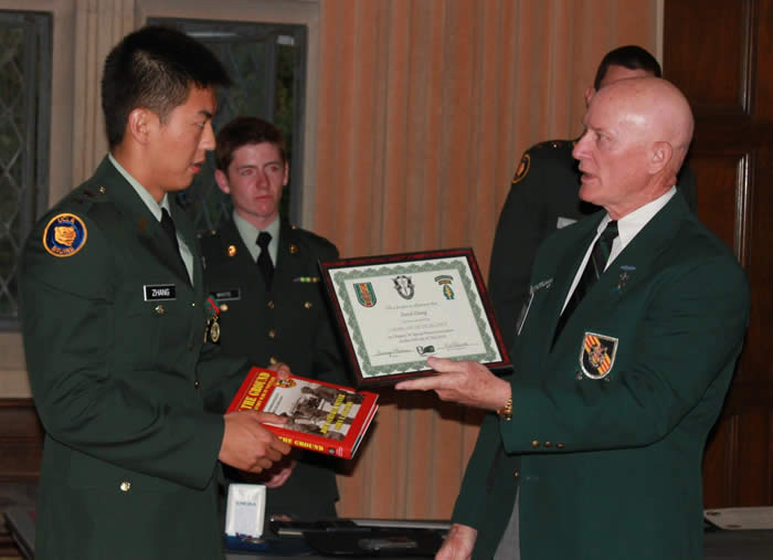 University of California at Los Angeles ROTC Battalion Professor of Military Science LTC David Kramer, Commanding - Cadet David Zhang, Lonny Holmes presenting certificate.