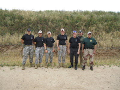 Zach Hartley (left) who led the Titan Battalion in action pistol training with SF 78.  SFA 78 Members on right.